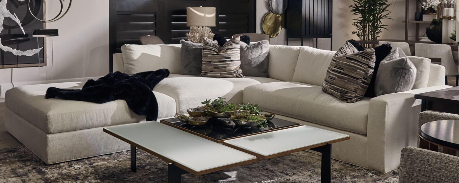 photo featuring the Gladiator 3-piece sectional with movable ottoman on casters for easy movement and configuration change