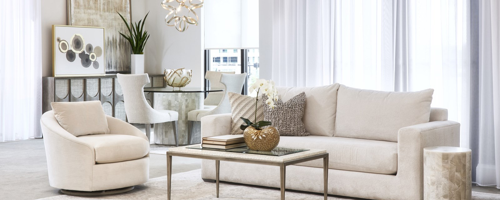 a photo of a living room setting featuring a New Traditions Garett sofa and side chair