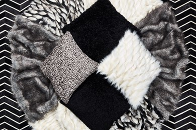 a top view photo of black and white contemporary pillows
