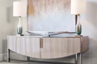 a photo of a contemporary sideboard in a showroom vignette